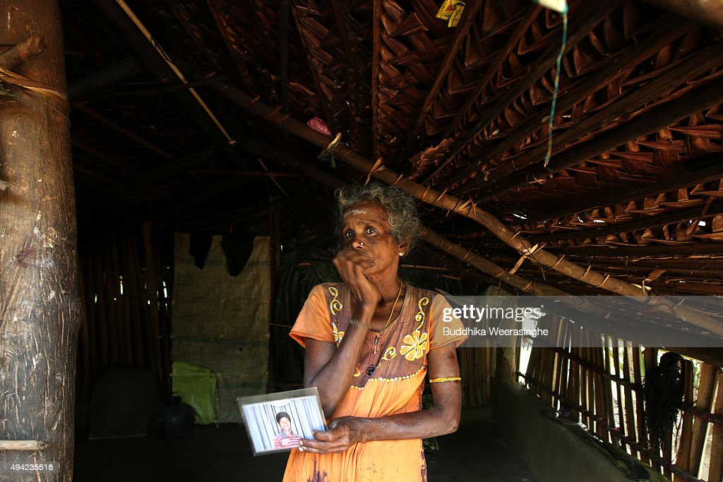 Sri Lankan ethnic Tamil woman named Krishna Lingam Joegeswary 53 years old holds her twenty nine years old missing sons picture at her residence on...