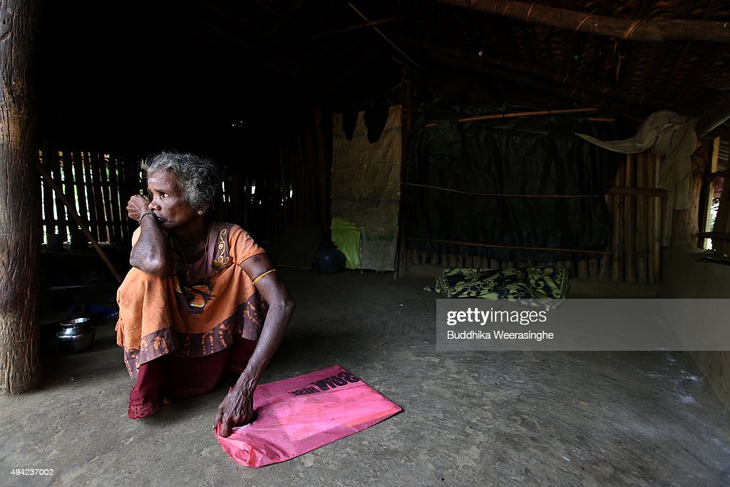 Sri Lankan ethnic Tamil woman named Krishna Lingam Joegeswary 53 years old holds her twenty nine year old missing sons picture and documents bag at...