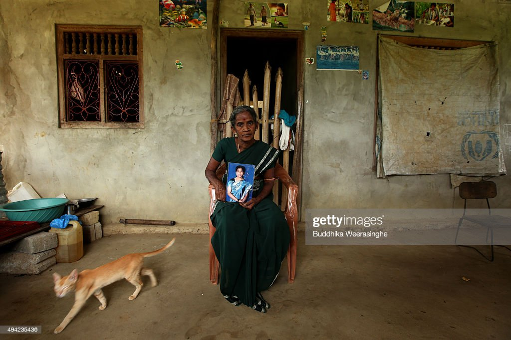 Sri Lankan ethnic Tamil woman named Suntharam Rajeswary 65 years old holds her missing a young daughter picture on October 25 2015 in Kilinochchi Sri...