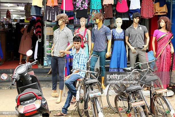 Sri Lankan ethnic Tamil young man sits on his bicycle front of the garment shop on October 24 2015 in Jaffna Sri Lanka Sri Lankan Prime Minister...