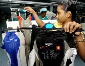 Sri Lankan factory executive Kiri Poruwage Deepa shows a hightech shark skinmimicking Fastskin FSII swimsuits made for Olympic squads at the Linea...