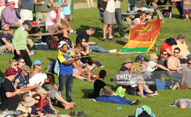 A Sri Lankan fan waves his flag during the tour match at The Spitfire Ground Kent