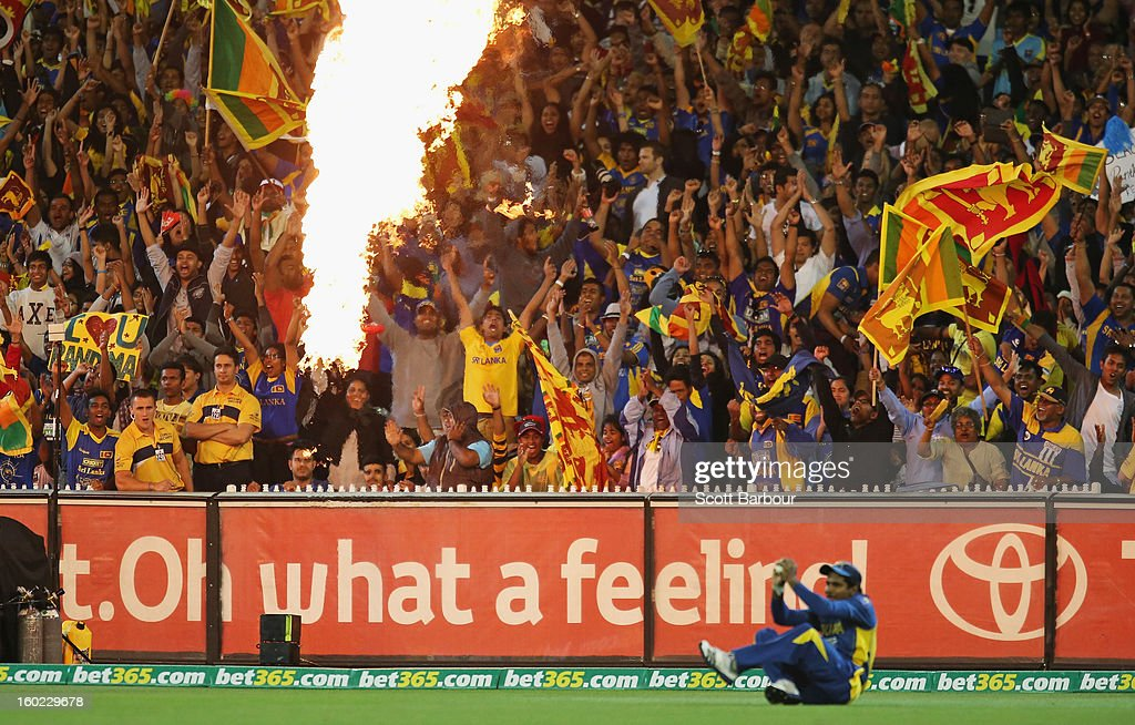Sri Lankan fans celebrate after Kushal Janith Perera of Sri Lanka took a catch on the boundary to dismiss George Bailey of Australia during game two of the Twenty20 International series between Australia and Sri Lanka at the Melbourne Cricket Ground on January 28, 2013 in Melbourne, Australia.