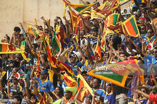 Sri Lankan fans celebrate the fall of an Australian wicket during game four of the Commonwealth Bank one day international series between Australia...
