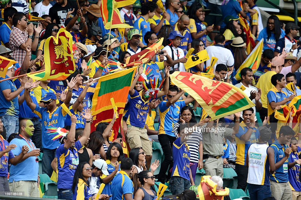 Sri Lankan fans celebrate the wicket of Australian captain Michael Clarke during game four of the Commonwealth Bank one-day international cricket series at the SCG in Sydney on January 20, 2013.