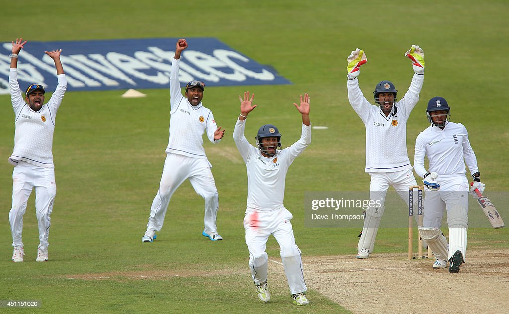 Sri Lankan fielders appeal successfully for the wicket of Chris Jordan of England after he was trapped LBW by Rangana Herath of Sri Lanka during day five of the 2nd Investec Test match between England and Sri Lanka at Headingley Cricket Ground on June 24, 2014 in Leeds, England.
