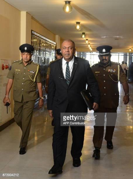 Sri Lankan Finance Minister Mangala Samaraweera arrives at parliament to present the annual budget for 2018 in Colombo on November 9 2017 Sri Lanka...