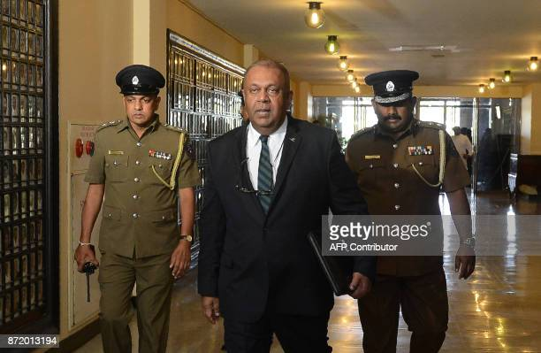 Sri Lankan Finance Minister Mangala Samaraweera arrives at parliament to present the annual budget for 2018 at the parliament on November 9 2017 Sri...