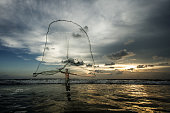 Sri Lankan fisherman with net