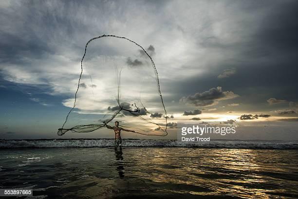 Sri Lankan fisherman with net