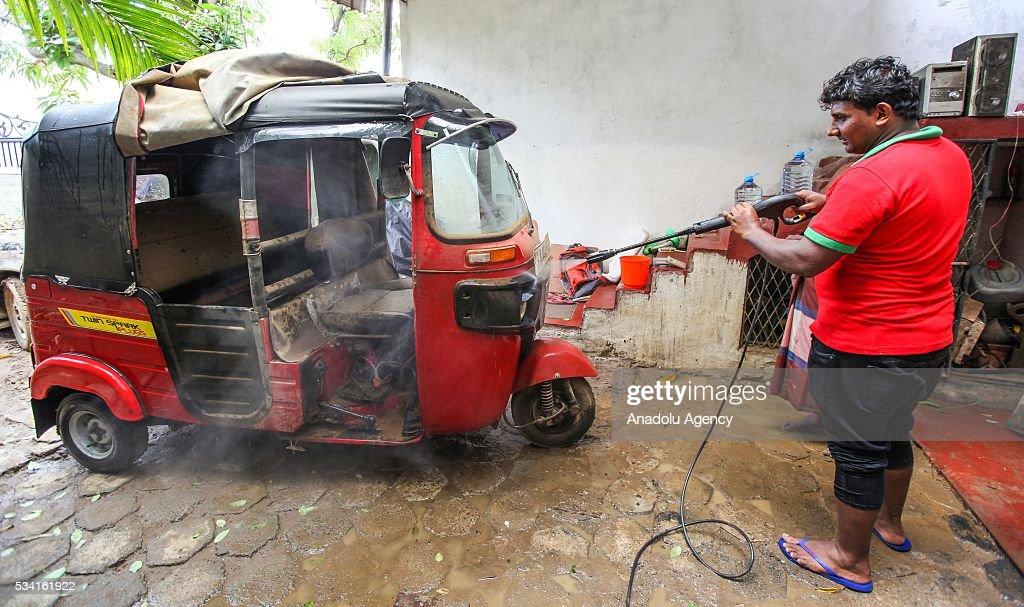A Sri Lankan flood victim cleans as the water level starts to decline in Wellampitiya, neighborhood of Colombo, Sri Lanka on May 25, 2016.