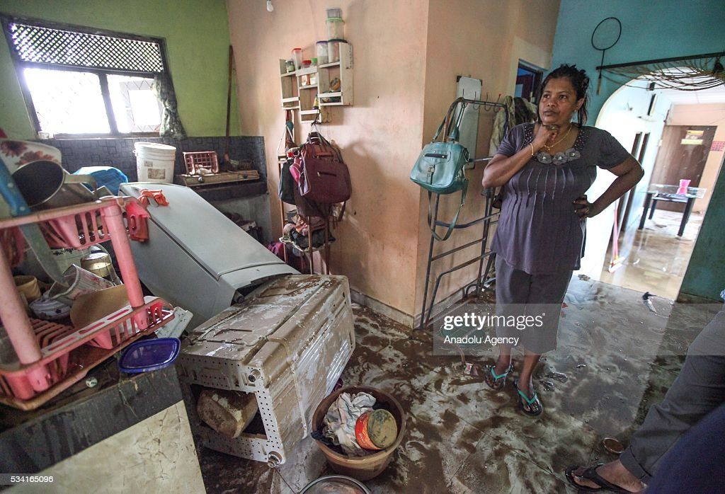 A Sri Lankan flood victim is seen at her house as the water level starts to decline in Wellampitiya, neighborhood of Colombo, Sri Lanka on May 25, 2016.