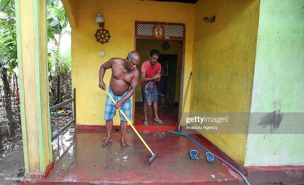 Sri Lankan flood victims clean their house as the water level starts to decline in Wellampitiya, neighborhood of Colombo, Sri Lanka on May 25, 2016.