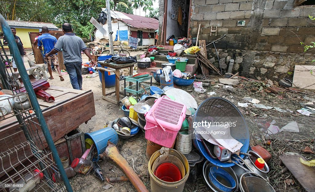 Sri Lankan flood victims clean their house as the water level starts to decline in Wellampitiya, neighborhood of Colombo, Sri Lanka on May 25, 2016.