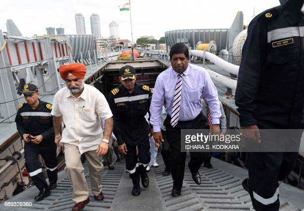 Sri Lankan Foreign Minister Ravi Karunanayake chats with Taranjit Singh Sandhu High Commissioner of India to Sri Lanka at Colombo harbour in Colombo...