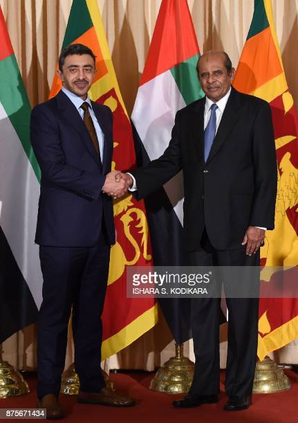 Sri Lankan Foreign Minister Tilak Marapana shakes hands with Minister of Foreign Affairs and International Cooperation of the United Arab Emirates...