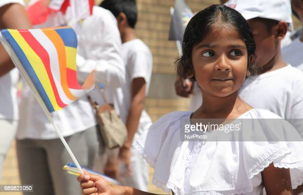 Sri Lankan girl holds a Buddhist flag during the festival of Vesak in Mississauga Ontario Canada on 28 May 2017 Vesak commonly known as Lord Buddha's...