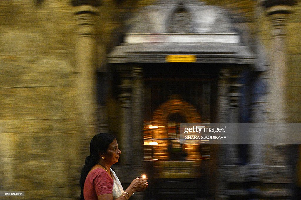 A Sri Lankan Hindu devotee prays during the Maha Shivaratri festival at a temple in Colombo on March 10, 2013. The festival of Maha Shivaratri is marked by Hindus fasting and offering prayers in a night long vigil. AFP PHOTO/ Ishara S. KODIKARA