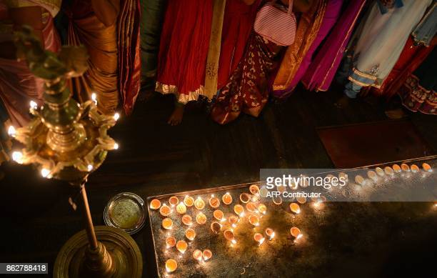 Sri Lankan Hindu devotees offer prayers during Diwali Festival at a temple in Colombo on October 18 2017 Diwali the Hindu festival of lights marks...