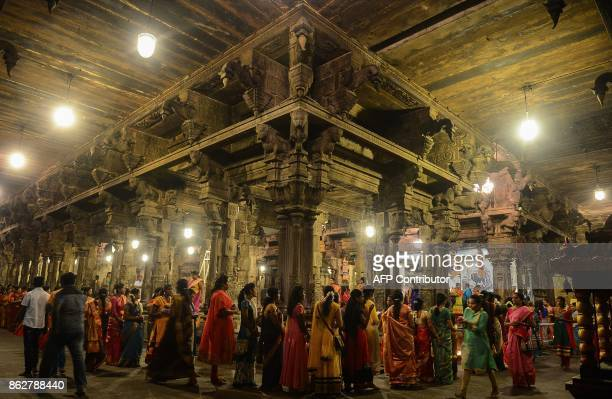 TOPSHOT Sri Lankan Hindu devotees offer prayers during Diwali Festival at a temple in Colombo on October 18 2017 Diwali the Hindu festival of lights...