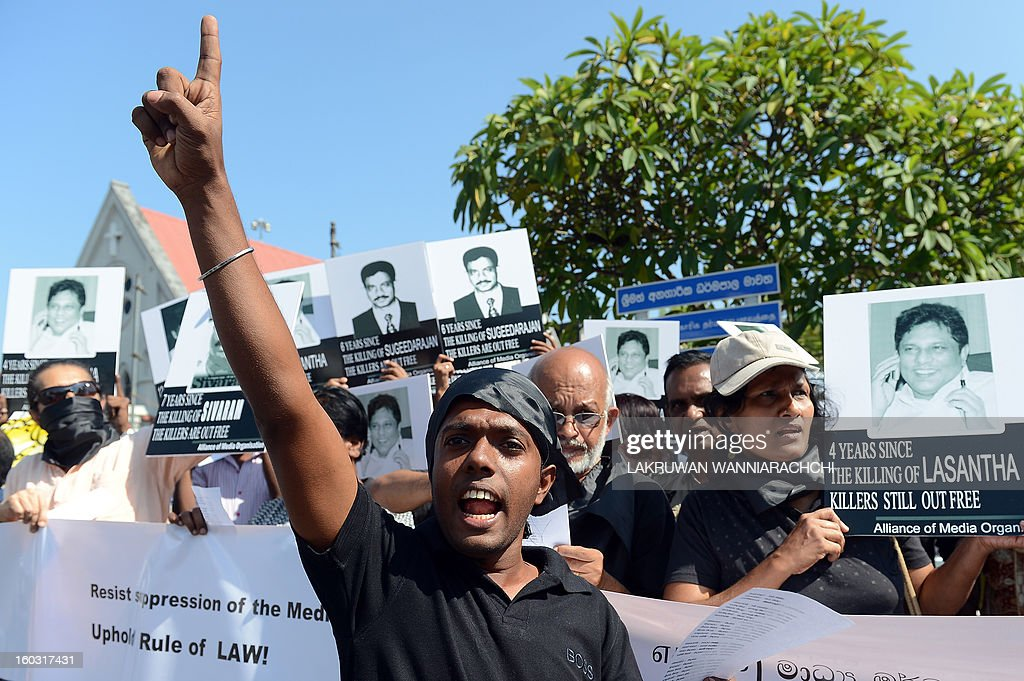 Sri Lankan journalists and media activists demonstrate, demanding investigations into over a dozen killings of editors, reporters and newspaper workers in recent years, in the capital Colombo on January 29, 2013. The protest came as three senior US officials were visiting Sri Lanka to press the authorities to deliver on promises of accountability for alleged human rights violations and ensure media freedom in a country emerging from nearly four decades of ethnic bloodshed. AFP PHOTO/ LAKRUWAN WANNIARACHCHI