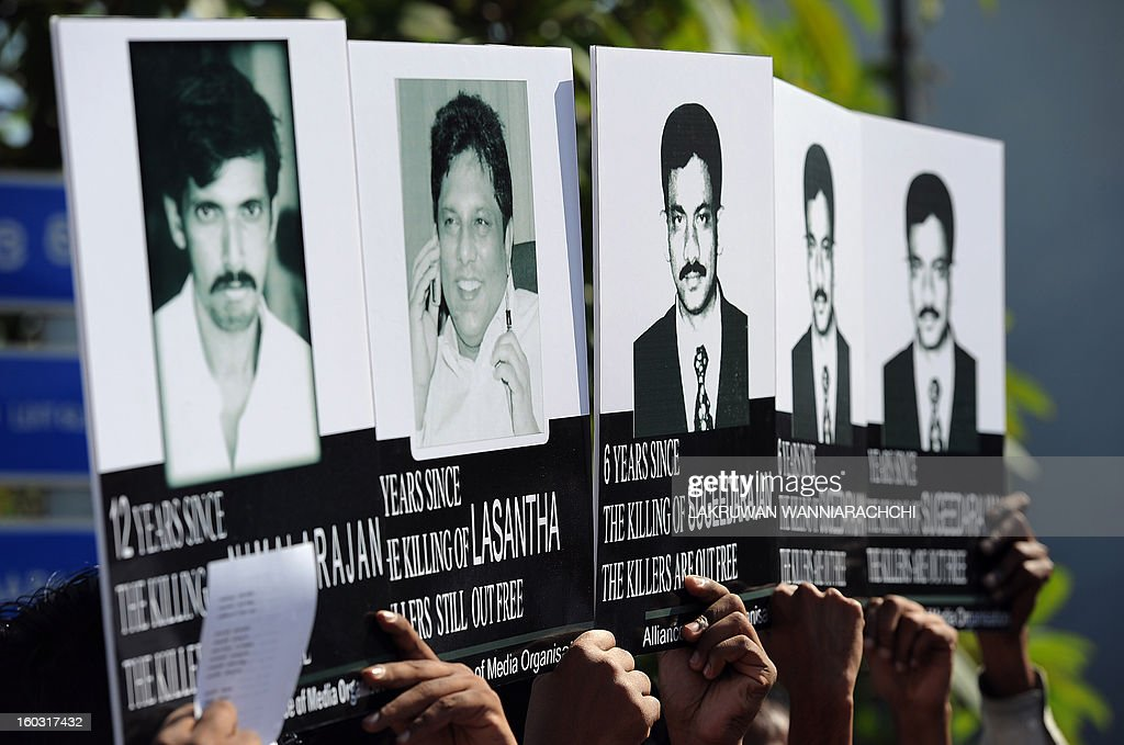 Sri Lankan journalists and media activists demonstrate, demanding investigations into over a dozen killings of editors, reporters and newspaper workers in recent years, in the capital Colombo on January 29, 2013. The protest came as three senior US officials were visiting Sri Lanka to press the authorities to deliver on promises of accountability for alleged human rights violations and ensure media freedom in a country emerging from nearly four decades of ethnic bloodshed.