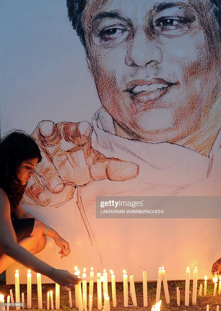 Sri Lankan journalists and well wishers light candles in front of a photograph of slain editor Lasantha Wickrematunge in the capital Colombo on January 8, 2013, on his fourth death anniversary. International media rights groups criticised Sri Lanka for failing to identify the assassins of Wickrematunge, a top anti-establishment editor.
