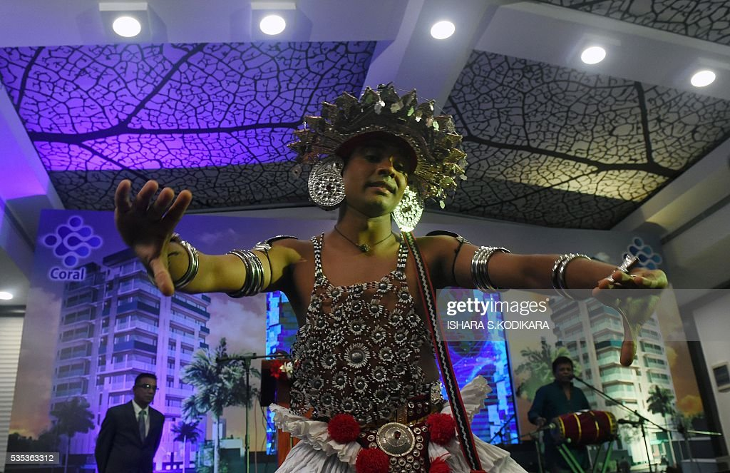 A Sri Lankan Kandyan dancer performs during the launching of Coral luxury apartment and hotel ceremony in Colombo on May 29, 2016. / AFP / ISHARA