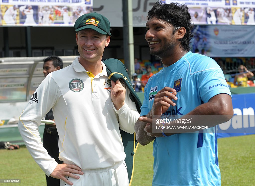 Sri Lankan Kumar Sangakkara shares a light moment with Australian team captain Michael Clarke before the start first day of the third and final Test...