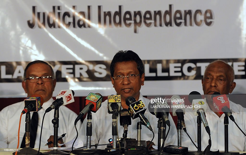 Sri Lankan lawyer J. C. Weliamuna (C) speaks during a press conference in Colombo January 14, 2013. Sri Lanka's lawyers announced legal action against the controversial sacking of chief justice Shirani Bandaranayake and vowed to keep up a battle for judicial independence.
