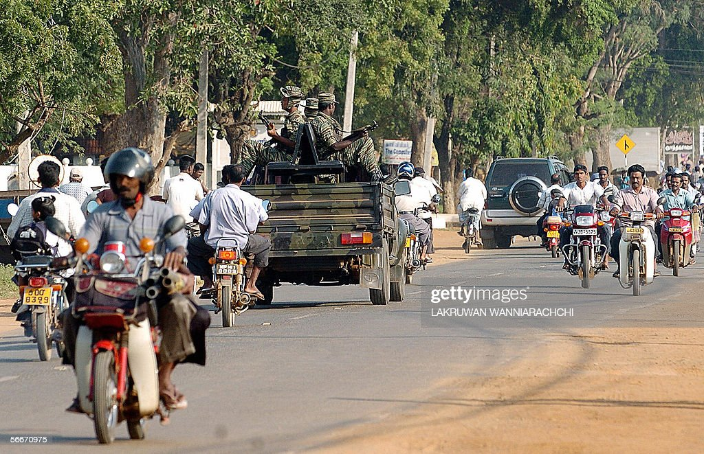 Sri Lankan Liberation for Tamil Eelam guerrillas ride in the rear of a vehicle as they patrol a street in the rebelheld town of Kilinochchi 25...