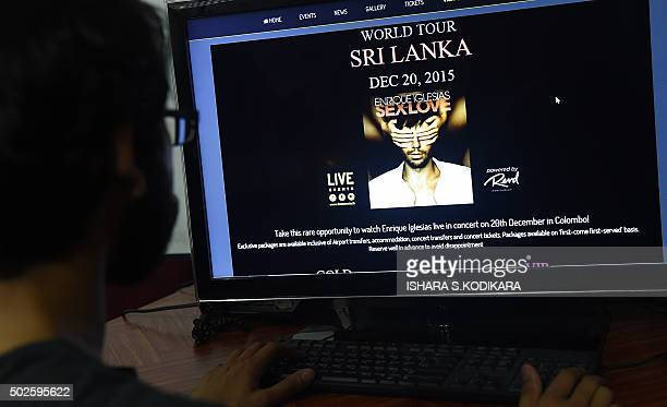 A Sri Lankan man checks the website of an event management company on a computer in Colombo on December 27 after organisers were publicly attacked by...