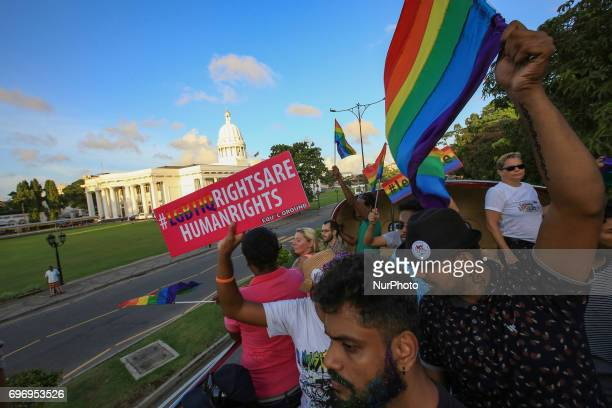 A Sri Lankan man holds a placard which states quot LGBTIQ rights are human rights' at Colombo Sri Lanka on Saturday 17 June 2017 In celebration of...