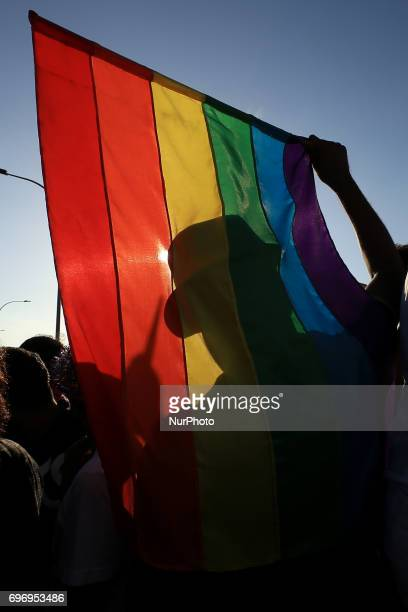 A Sri Lankan man is silhouetted against the rainbow flag at Colombo Sri Lanka on Saturday 17 June 2017 In celebration of Colombo Pride 2017 a '...