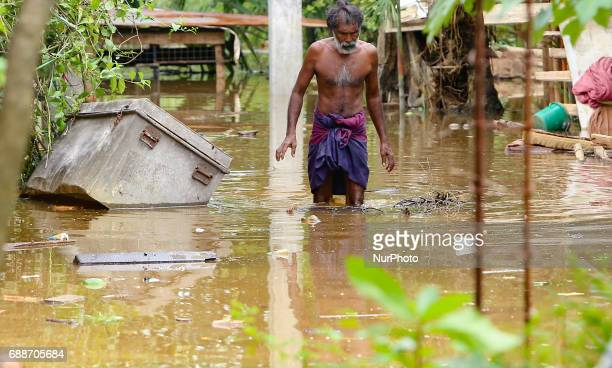 A Sri Lankan man walk across the his house inundated by floods at Kaduwela 20kms away from capital city Colombo Sri Lanka Friday 26th May 2017 More...
