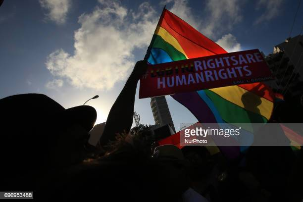 A Sri Lankan men are silhouetted against the rainbow flag at Colombo Sri Lanka on Saturday 17 June 2017 In celebration of Colombo Pride 2017 a '...