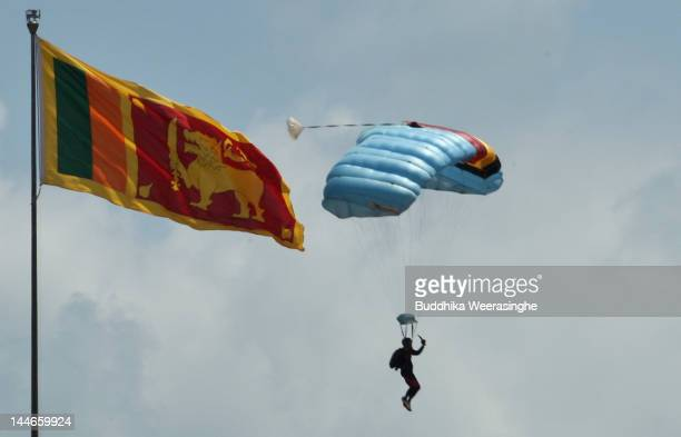 Sri Lankan military officer parachutes next to national flag during military parade rehearsals in preparation for the celebration of the third...