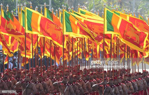 TOPSHOT Sri Lankan military personnel march with the national flag during the island's 69th Independence Day celebrations in Colombo on February 4...