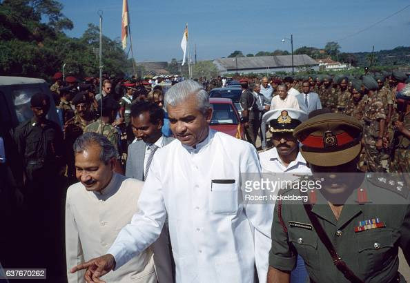 Sri Lankan Minister of Foreign Affairs Ranjan Wijeratne center walks with his cabinet assistants March 20 1990 before meeting Indian military...