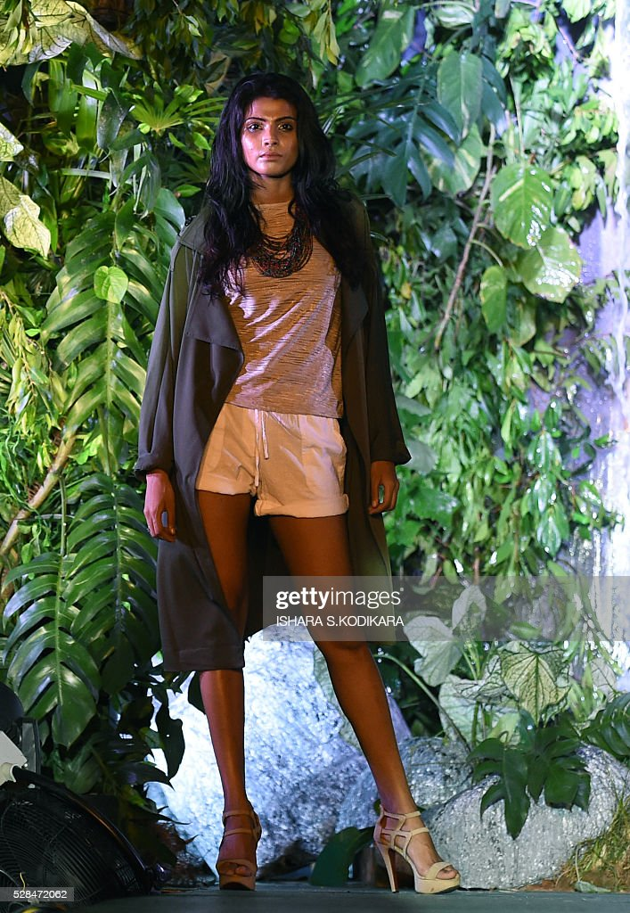 A Sri Lankan model presents a creation by local designer Odel during a Rain Forest fashion event in Colombo on May 5, 2016. / AFP / ISHARA