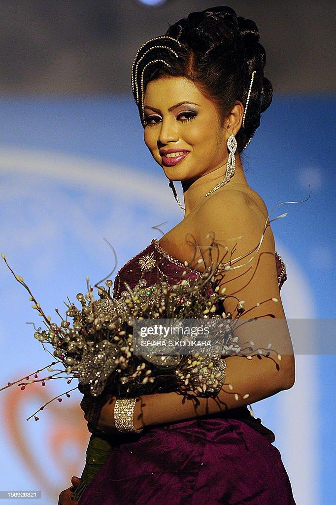 A Sri Lankan model shows off a bridal creation during a fashion show in Colombo on November 25, 2012. Clothing accounts for over half of Sri Lanka's 7.5 billion USD export earnings. AFP PHOTO/ Ishara S. KODIKARA