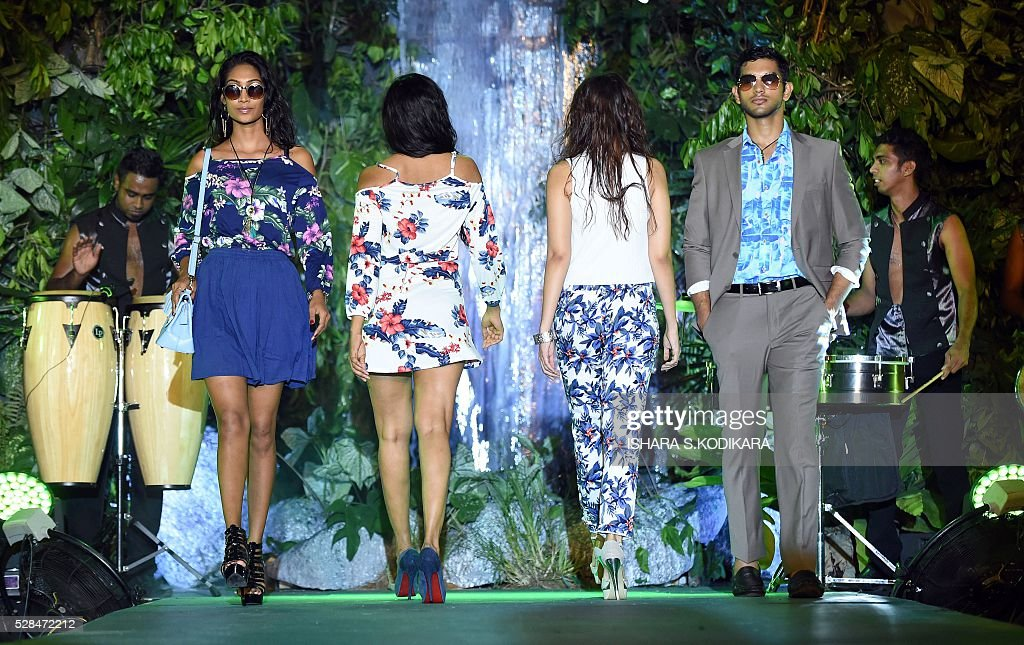 A Sri Lankan models present creations by local designer Odel during a Rain Forest fashion event in Colombo on May 5, 2016. / AFP / ISHARA