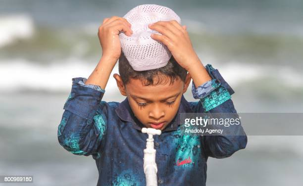 Sri Lankan Muslim boy performs ablution for the Eid alFitr prayer at the Galle Face green in Colombo Sri Lanka on July 26 2017 Eid alFitr is a...