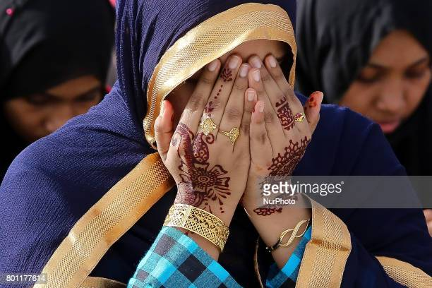 A Sri Lankan muslim girl prays during an Eid alFitr event to mark the end of the holy fasting month of Ramadan in Colombo Sri Lanka Monday 26 June...