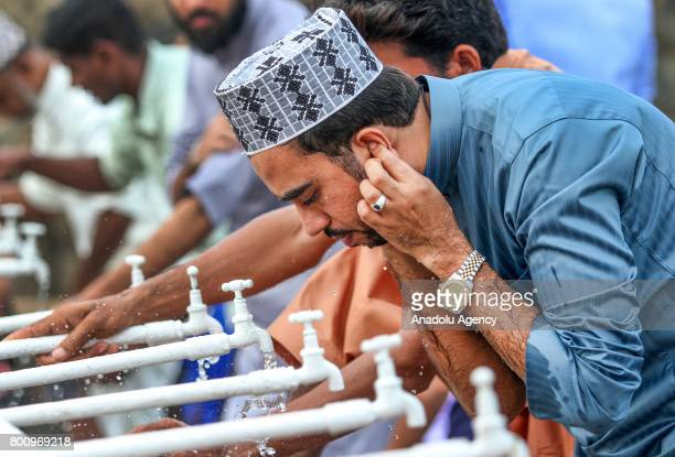 Sri Lankan Muslim man performs ablution for the Eid alFitr prayer at the Galle Face green in Colombo Sri Lanka on July 26 2017 Eid alFitr is a...