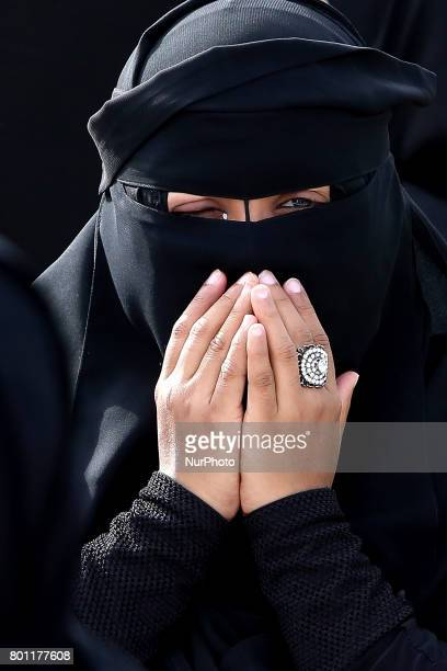A Sri Lankan muslim woman prays during an Eid alFitr event to mark the end of the holy fasting month of Ramadan in Colombo Sri Lanka Monday 26 June...