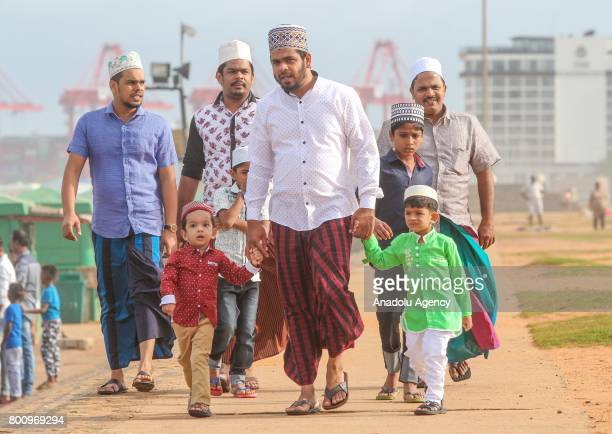Sri Lankan Muslims arrive to attend a Eid alFitr prayer during the Eid alFitr holiday at the Galle Face green in Colombo Sri Lanka on July 26 2017...