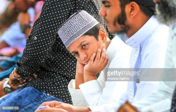 Sri Lankan Muslims gather to pray during the Eid alFitr prayer at the Galle Face green in Colombo Sri Lanka on July 26 2017 Eid alFitr is a religious...