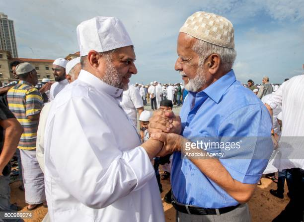 Sri Lankan Muslims greet each other after performing Eid alFitr prayer at the Galle Face green in Colombo Sri Lanka on July 26 2017 Eid alFitr is a...