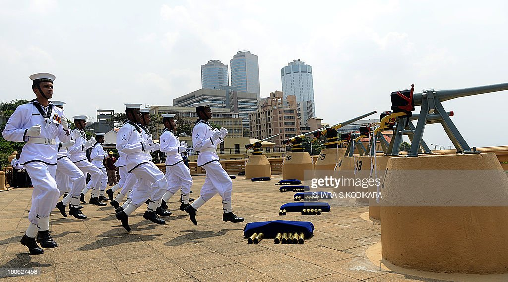 Sri Lankan Navy personnel prepare to fire a 21-gun salute on the capital's seafront Galle Face promenade to mark the island nation's 65th Independence Day in Colombo on February 4, 2013. Sri Lanka marked its freedom anniversary with a thinly veiled denunciation of Western moves to pass a new resolution against the island at the UN Human Rights Council. AFP PHOTO/Ishara S
